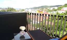 Phuket Tropical Property - Sea view condo in center of Patong for Sale